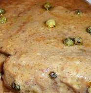 Filetto di vitello in mantello di calogna con salsa al rosmarino